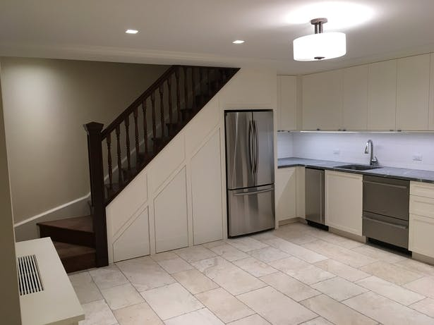 Cellar gut renovation with new kitchen and stair to match upper floors