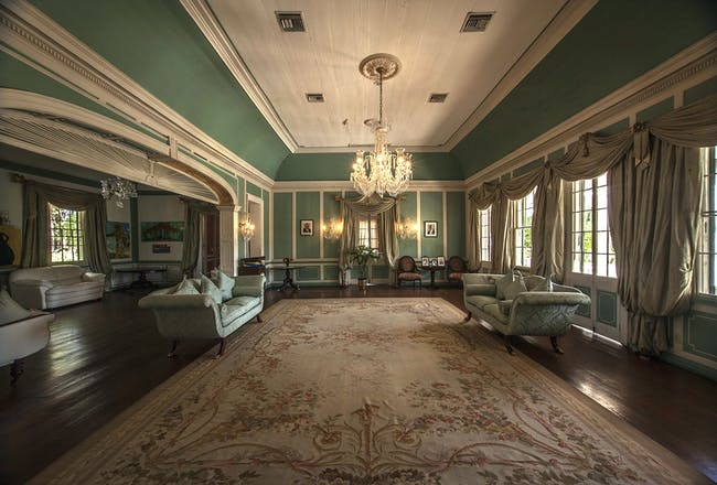 Government House, in St. John's, Antigua and Barbuda. View of a drawing room located on the ground floor of the main building and facing out on the deep front porch, 2015. Photo: Philip Logan