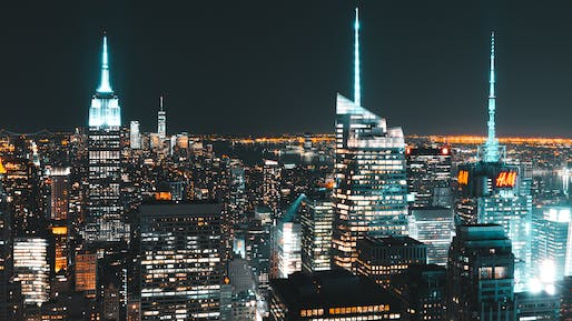 View of the Manhattan skyline at night. Image courtesy of Wikimedia user Kai Pilger