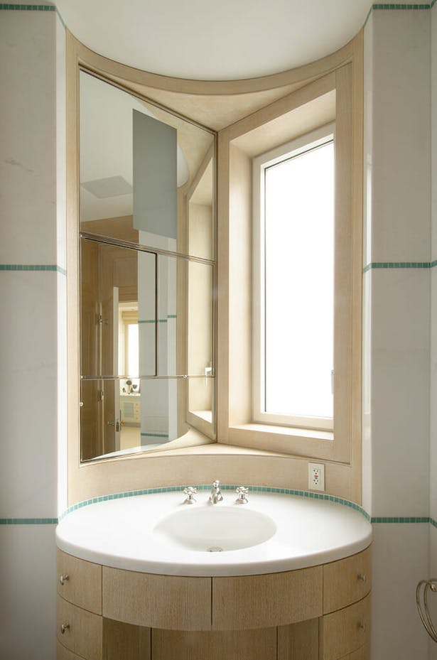 Bathroom vanity mirror can recede for additional space.