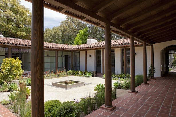 The courtyard was created with a central fountain, a decomposed granite surface and native plants.