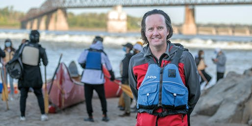 """Derek Hoeferlin, chair of Landscape Architecture & Urban Design in the Sam Fox School of Design & Visual Arts, leads students on a canoe trip along the Mississippi River, near the Chain of Rocks Bridge north of downtown St. Louis. The outing was part of Hoeferlin's fall 2020 studio """"Field Work 2.0,"""" which combined virtual and on-the-ground methods of documenting how various communities intersect with surrounding territories, watersheds and infrastructure. (Photo: Danny Reise)"""