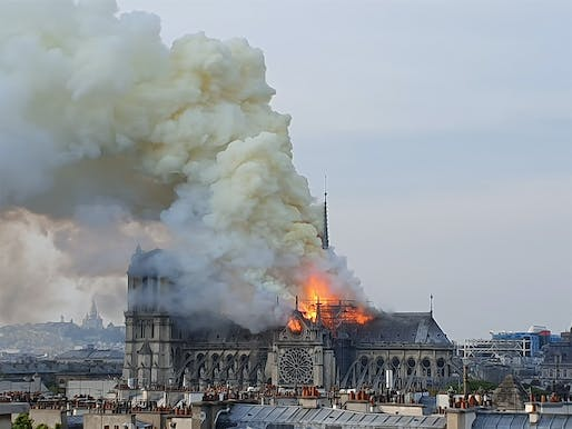 The 96-meter/315-ft-tall spire of Notre Dame cathedral engulfed in flames in the evening hours of April 15, 2019. Image: Wikimedia Commons user Marind.
