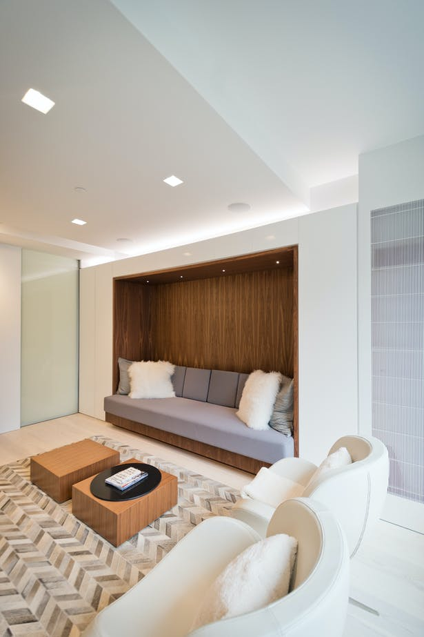 A Linear Light Above the TV Room Sofa Niche Elevates the Space