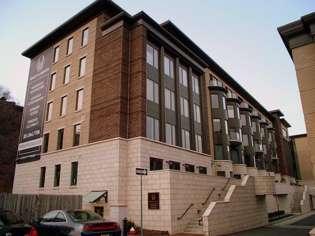 SOUTHEAST CORNER VIEW OF TYPICAL CONDOMINIUM BUILDING