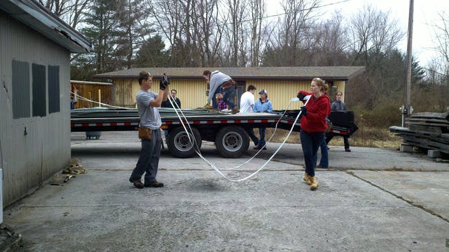 Anna and Ryan help unload the leftover Alpolic