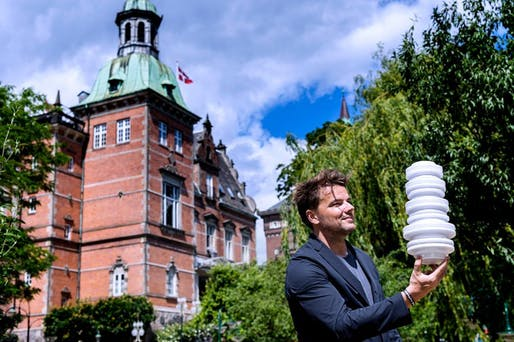 Bjarke Ingels posing with model of H.C. Anderson Hotel on site. Photo by by Bax Lindhardt.