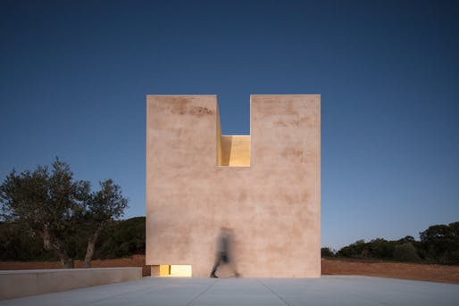 West façade at night. A small lamp inside the chapel lights up the entrance patio. All images courtesy of João Morgado.