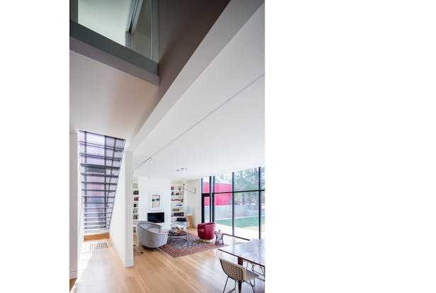The double-height space that marks the transition from the original house to the new addition.