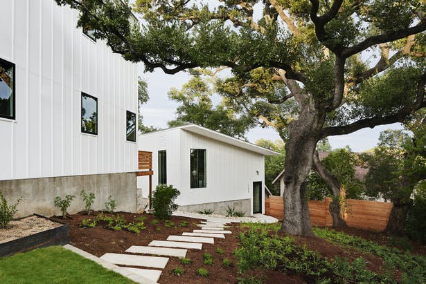 Due to the site constraints and placement of the houses, conventional yards are not included. Instead, we landscaped everything in front and back of the homes to be usable as a garden, a path, or some other form of outside experience.