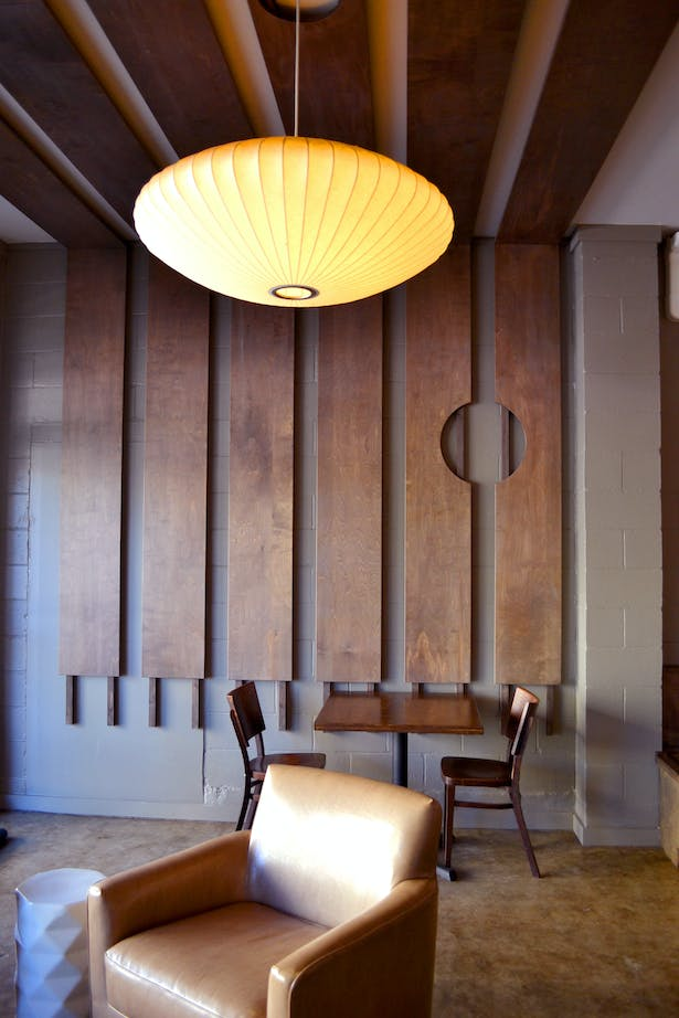 New wood paneling folds over the walls and ceiling