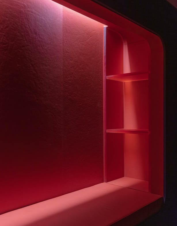 Illuminated custom ecoresin shelves. Each nook has concealed power outlets for study and reading devices.