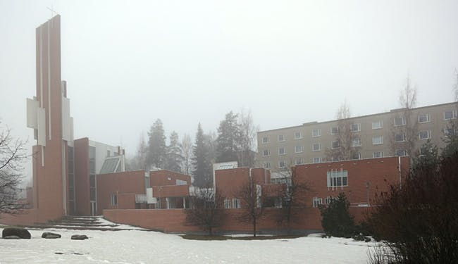 A haze shrouded Männistö Church by Juha Leiviskä in Kupio, Finland.