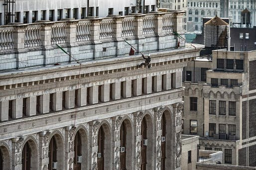 "A rope-access building inspector working for Howard L. Zimmerman Architects rappels down the Flatiron Building to survey its historic facade for safety issues. Photo: Jack Kucy, image via @hlzarchitects/<a href=""https://www.instagram.com/p/BsyZtiSASjx/"">Instagram</a>."