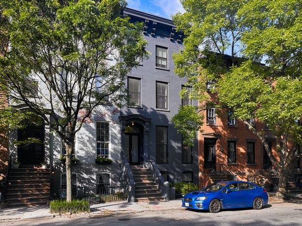 This nine single-room occupancy apartment building was converted into a two-family residence.