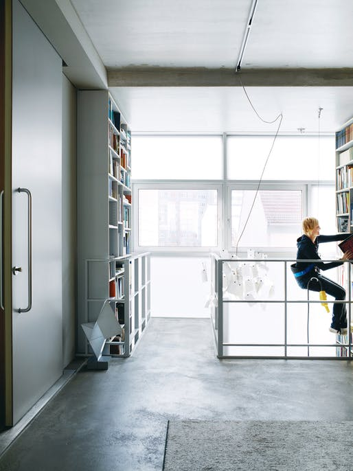 Dulkinys uses the remote-controlled mountaineer's harness to peruse the two-story bookshelf. Photo by: Pia Ulin