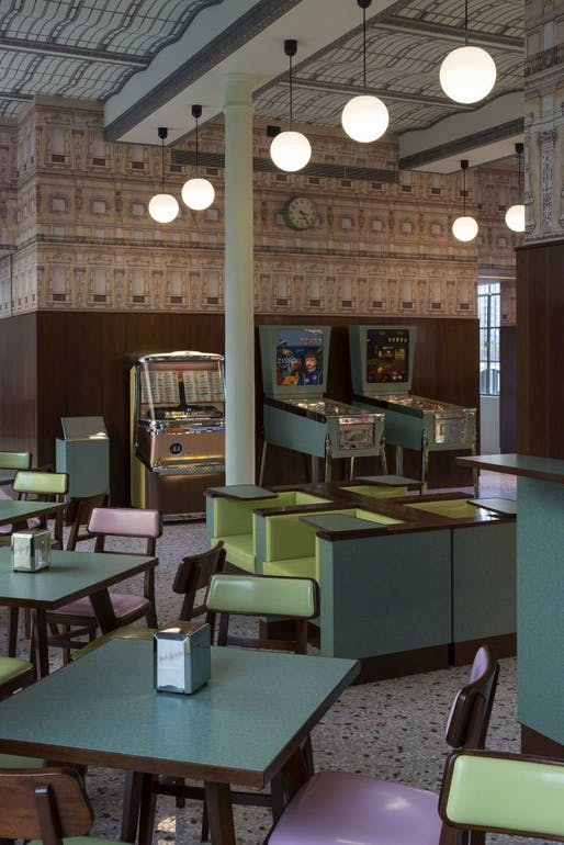 "Wes Anderson's Bar Luce, which opens May 9 at the Prada Foundation Arts Complex in Milan, takes inspiration from a ""typical"" 1950 Milanese café. Yes, including a Steve Zissou pinball machine. (Photo: Fondazione Prada; Image via qz.com)"