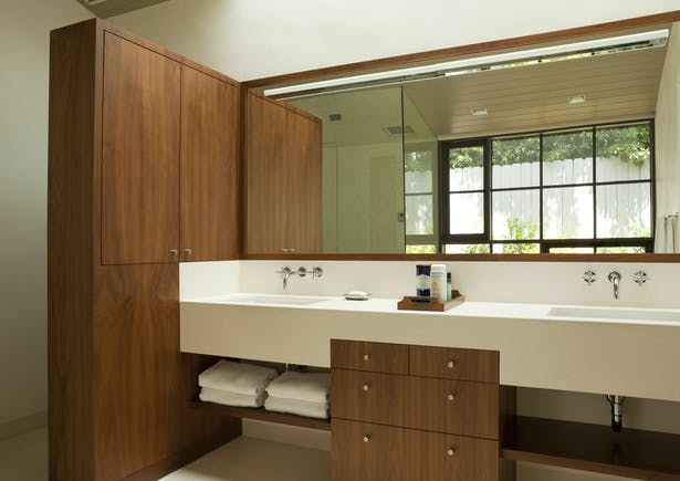 The master bathroom features a custom limestone and walnut vanity.