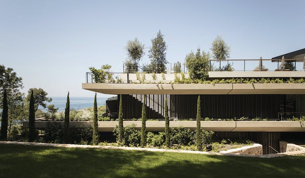 Green terraces of the apartments and the pool area