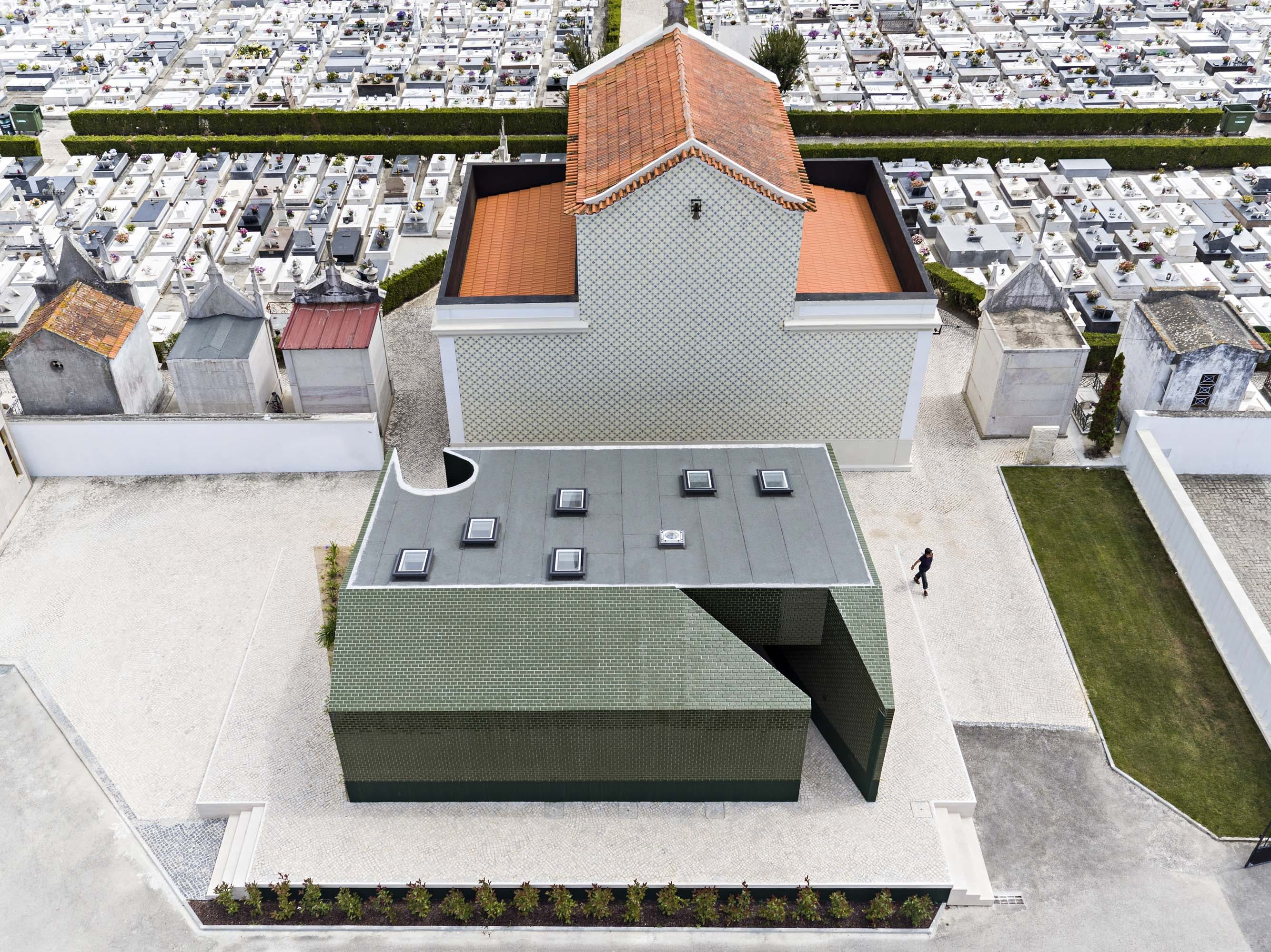 m2.senos creates a public restroom coated in green ceramic tile for ...