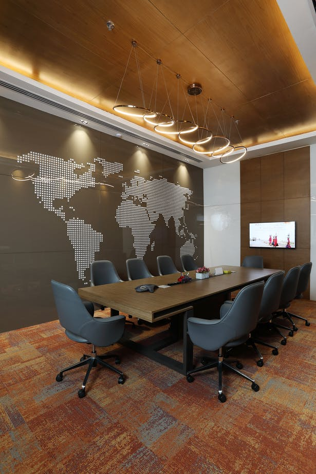 Conference Room: State of the art conference room with a world map done in lacquered glass as a feature wall, to depict the company's presence across the globe.