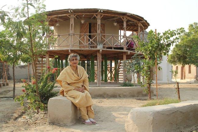 Yasmeen Lari outside a women's centre on stilts to survive floods in Sindh via nutscienceblog.files.wordpress.com