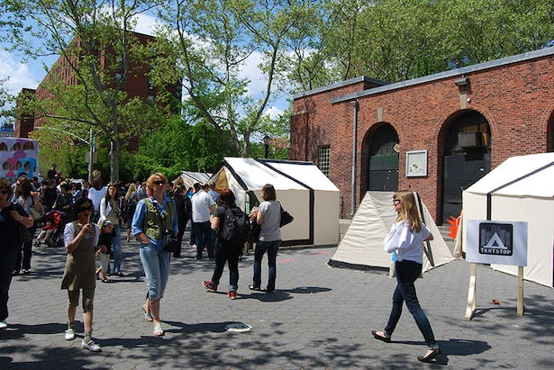 Festival visitors walk by our campground exhibition.