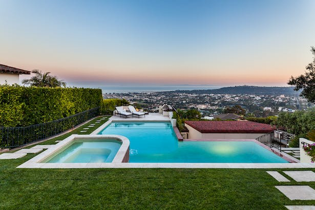 quaint hillside retreat | stunning view property. infinity edge swimming pool design + waterfall fountain. hand crafted iron details | classic santa barbara style. 3388 sf