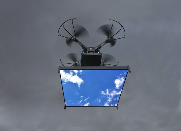 The drone flying with the digital video monitor and images of the sky.