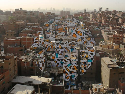"The piece ""Perception"" by Tunisian-French artist eL Seed spans over numerous brick buildings in Cairo's neglected Manshiyat Naser neighborhood. (Photo: eL Seed; Image via techinsider.io)"