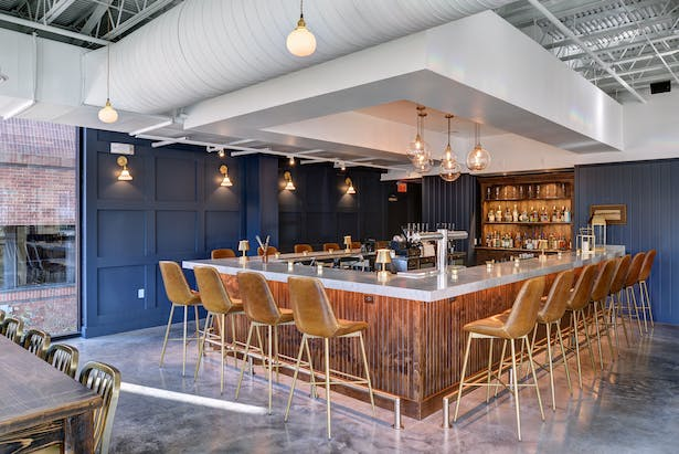 Bar highlighted with accent wall. Image courtesy JZA+D.