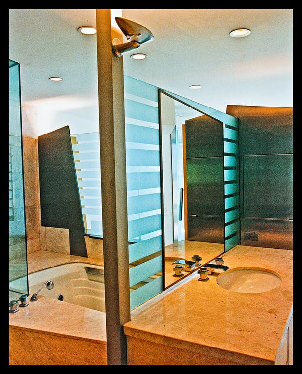 blasted glass/mirror partition between sink and tub area