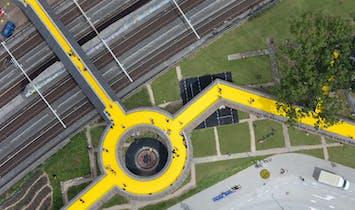 Follow the yellow wooden road into Rotterdam's new Luchtsingel pedestrian park