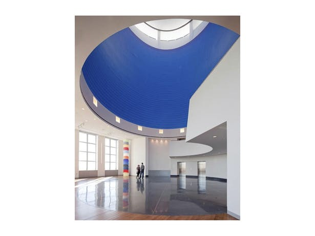 Ron Gorchov- 'Totem' art installation with Sol LeWitt - 'Wall Drawing #832 A Red Spiral on Blue' art installation above / Photo by Paul Warchol