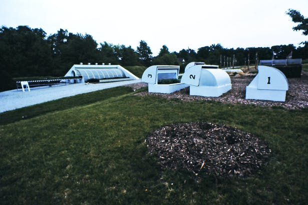 View of our experimental organic gardens, greenhouse, and insulated cold frames.