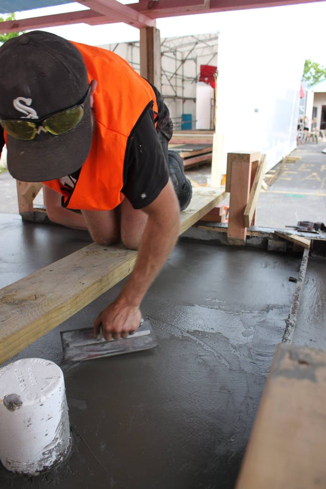James smoothing the surface of the concrete