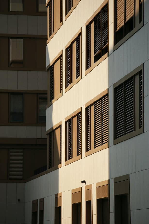 Facade detail – the façade features only two materials: aluminium window frames and ceramic tiles