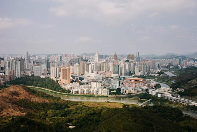 Shenzhen in 2015 from Hong Kong's Crest Hill. Image via the Guardian