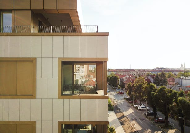 Large window openings positioned within emphasized frames are the key feature of the facade design