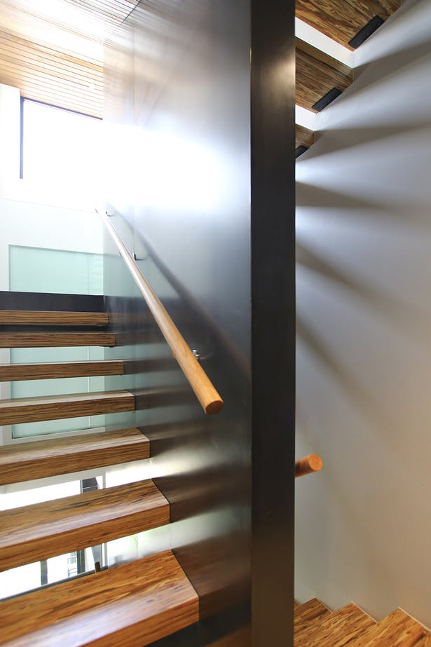 Open Tread Stair Made from Parallam Beams Stitches All Five Levels Together