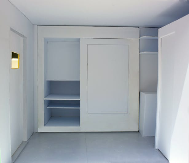 This is one of the pullouts that would contain a workspace, storage, and a closet.