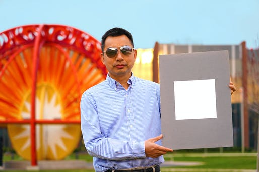 Xiulin Ruan, a Purdue University professor of mechanical engineering, holds up a sample of what his lab claims is the whitest paint on record. Credit: Purdue University/Jared Pike.