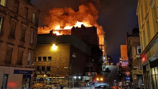 "The Glasgow School of Art's Mackintosh Building on fire on June 16. Photo via STV News/<a href=""https://twitter.com/STVNews/status/1007771904558686208"">Twitter</a>."