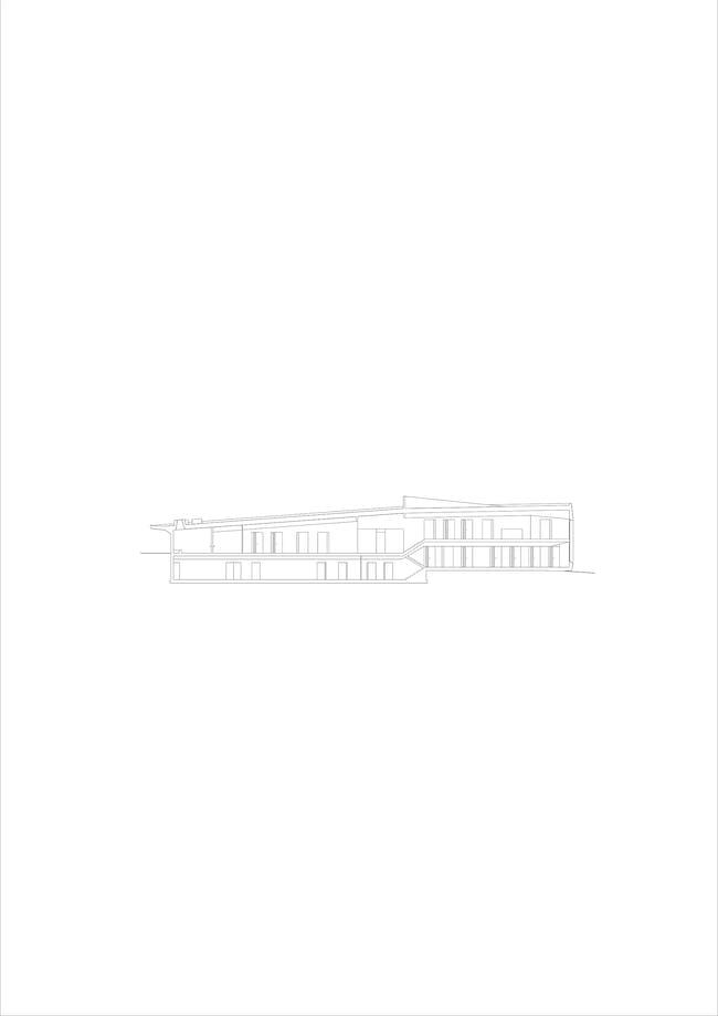 Longitudinal section. Image courtesy of Roeoesli & Maeder Architects.