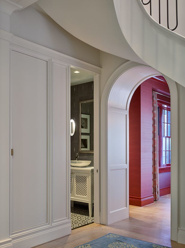 The curved archways allow the colors from adjoining rooms to play off one another.