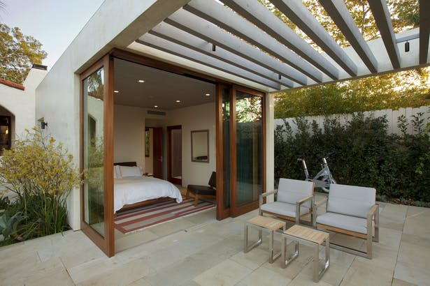 The guest house opens up to a covered terrace.