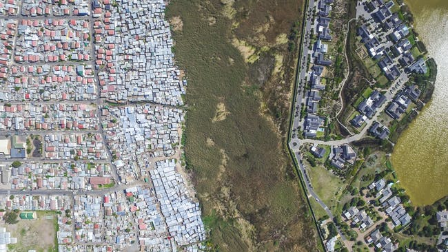 Masiphumelele / Lake Michelle, Cape Town, South Africa, from the drone photo series 'Unequal Scenes' by Johnny Miller.