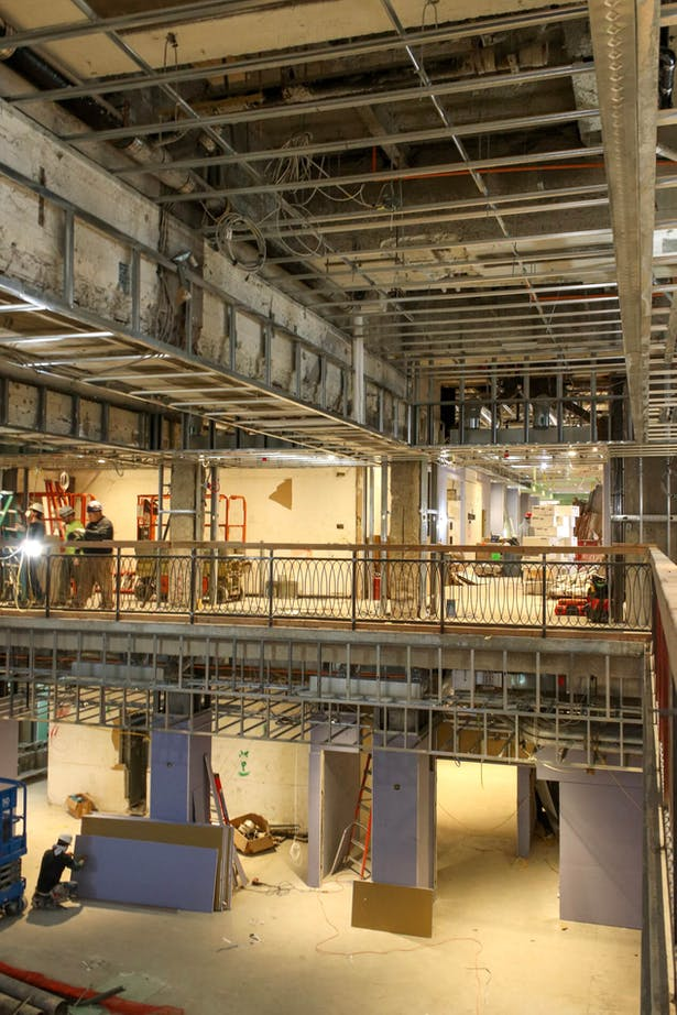 View of Dining Hall double height space with existing deep beams
