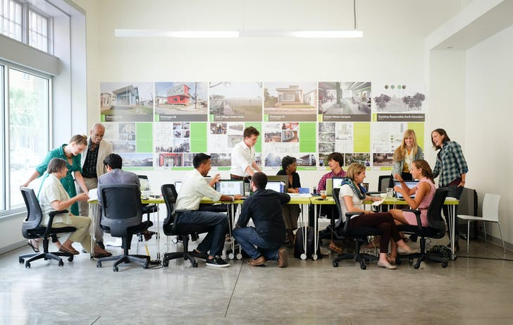 Tulane City Center Staff and Public Interest Design Fellows in the new community design center in Central City. Image courtesy of Tulane School of Architecture.