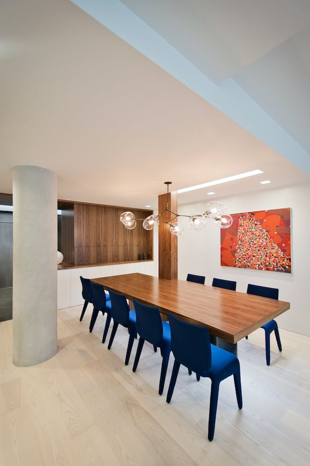 A Careful Lighting Composition as the Dining Table Helps Define Space